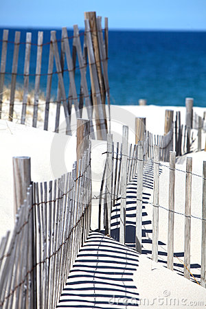 Beach Fence and Blue Ocean