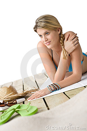 Beach - Happy woman relax on wooden plank
