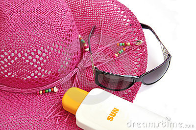 Beach hat, bottle of balm solar.