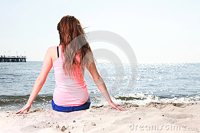 Beach holidays woman enjoying summer sun sitting sand
