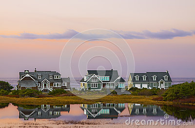 Beach House Sunset Reflections