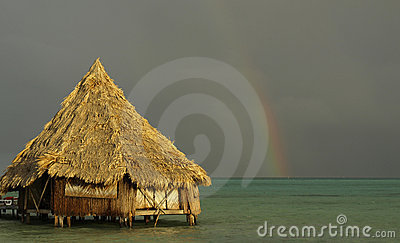 Beach hut & rainbow post storm