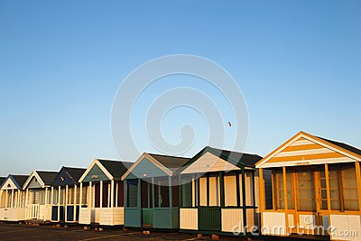 Beach huts in golden sunlight