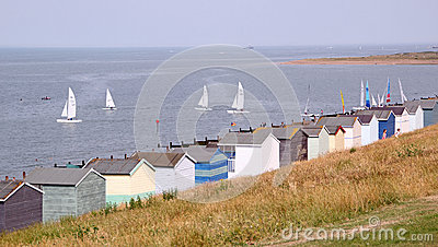 Beach huts and yachts Editorial Stock Image