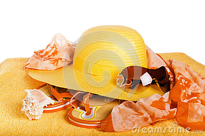 Beach items a hat, a towel and slippers, it is isolated on white
