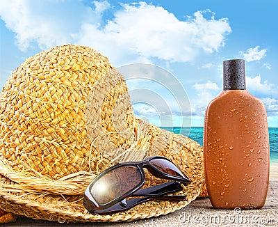 Beach items and suntan lotion at the beach