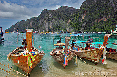 Beach on Ko Phi Phi, Thailand with long tail boats