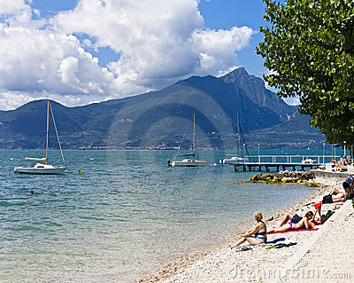 Beach of Lake Garda at Torri del Benaco Editorial Stock Image