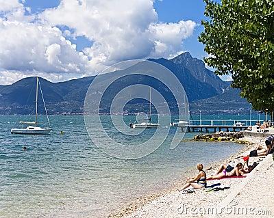 Beach of Lake Garda at Torri del Benaco Editorial Stock Image