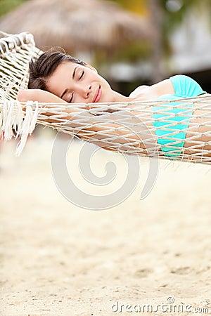 Beach lifestyle woman in hammock