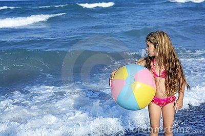 Beach little girl colorful ball playing