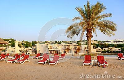 Beach of the luxury hotel during sunset