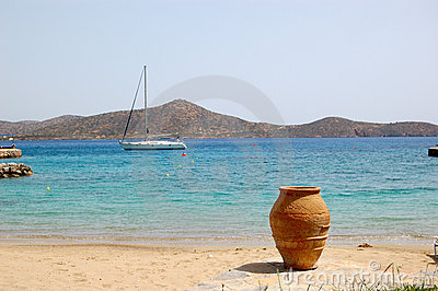 Beach of luxury hotel with yacht and amphora