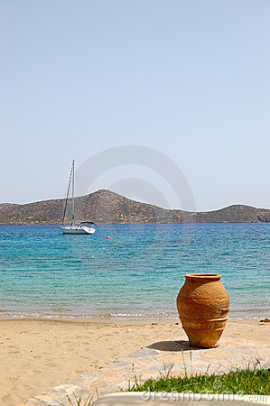 Beach of luxury hotel with yacht and amphora view