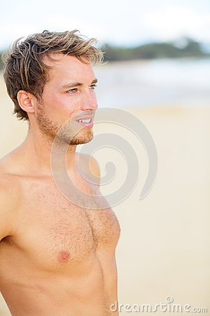 Beach man looking at ocean
