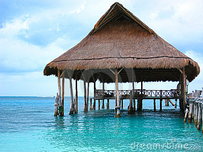 Beach Pier with Palapa Hut on Ocean