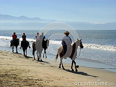 Beach riders Stock Photo