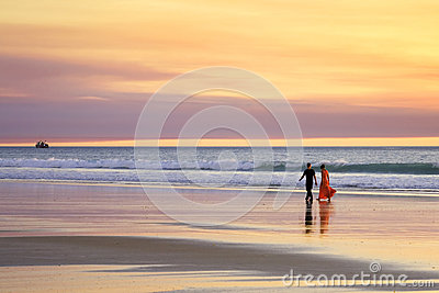 Beach Romantic Young Couple Walking Edge of Sea at Sunset