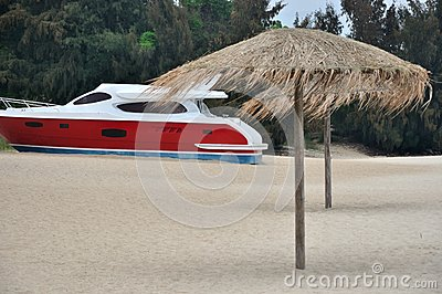 Beach sand and red yacht