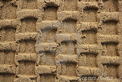 Beach sand texture with vehicle tires footprint