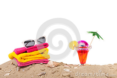 Beach sand with towels and cocktail