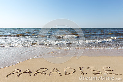 Beach with sand word paradise