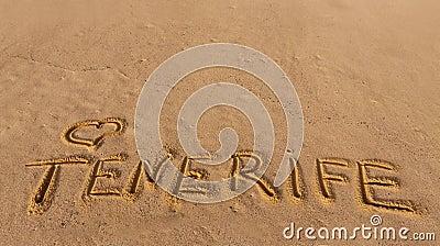 Beach sand with written word Tenerife