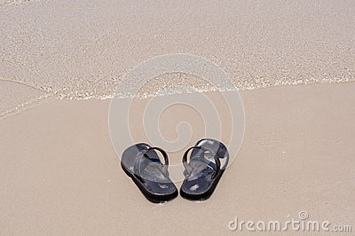 Beach sandals on a sandy beach
