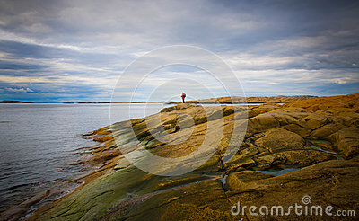 Beach scenery with distant person