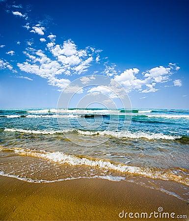 Beach, sea and cloudy sky