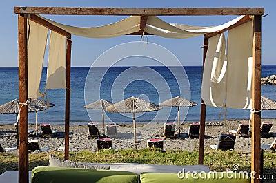 Beach sunbeds and umbrellas