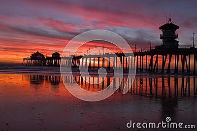 Beach sunset and pier