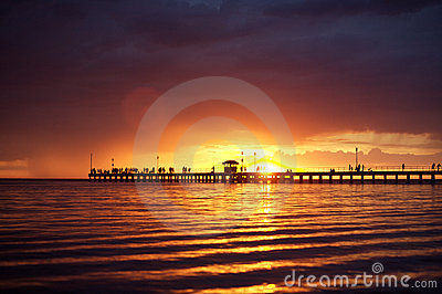 Beach sunset or sunrise and a wooden pier
