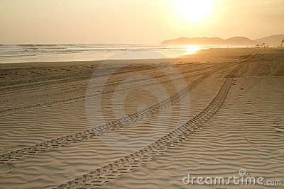 Beach Sunset With Tire Tracks