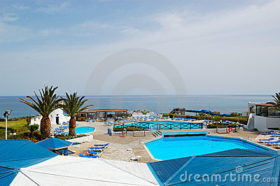Beach and swimming pool area of popular hotel