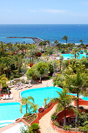 Beach and swimming pool at the luxury hotel