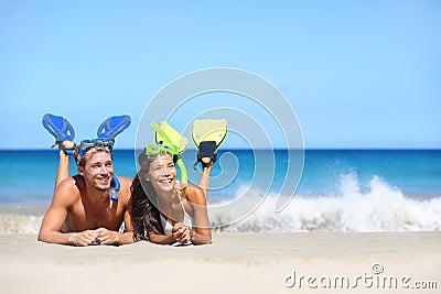 Beach travel couple having fun snorkeling looking