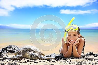 Beach travel woman on Hawaii with sea sea turtle