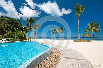 Beach with tropical pool