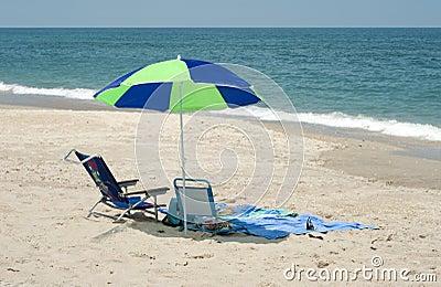 Beach Umbrella and Chair by Ocean