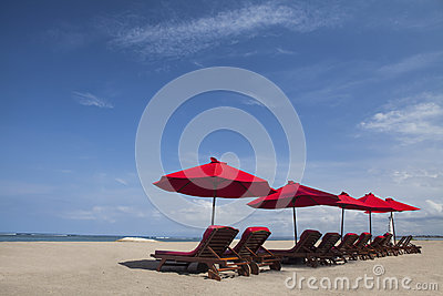 Beach umbrella chairs in paradise island