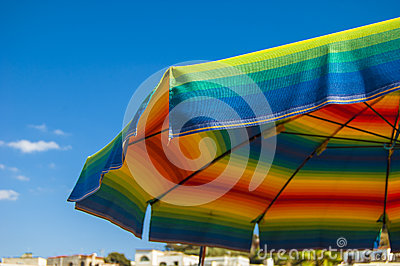 Beach umbrella colored like a rainbow