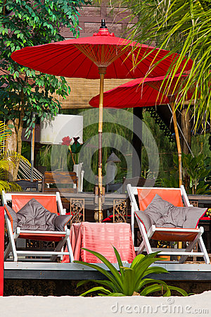 Beach umbrella and deck chairs on the beach