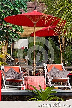 Beach umbrella and deck chairs on the beach