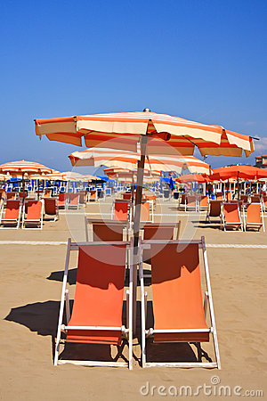 Beach umbrella and deckchairs