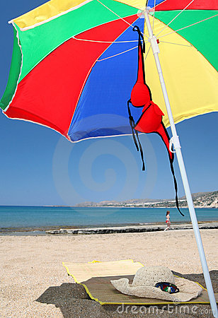 Free Beach Umbrella Mat Hat Bikini And Sunglasses Stock Image - 5428601