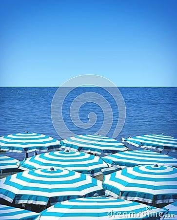 Beach umbrellas and sea