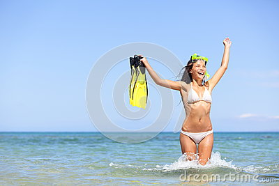 Beach vacation woman excited and happy snorkeling