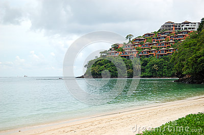 Beach with a view on lagoon with luxury villas on hill