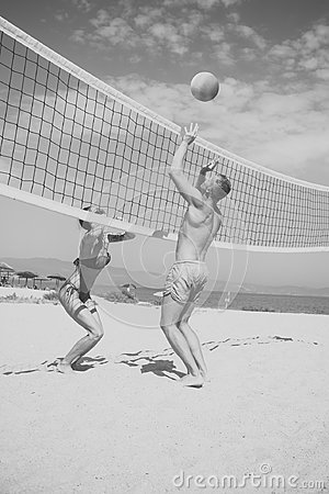 Free Beach Volleyball Concept. Couple Have Fun Playing Volleyball. Young Sporty Active Couple Beat Off Volley Ball, Play Game Stock Images - 116131364